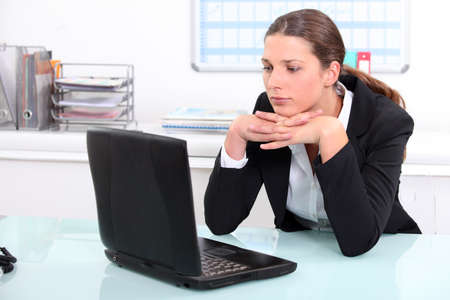 inattentive: Brunette businesswoman bored at work Stock Photo