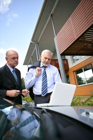 Two senior sales men on hous call Stock Photo - 11971703