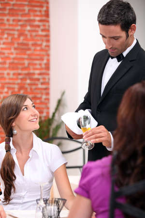 waiter serving wine photo