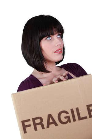 Girl with cardboard, studio shot Stock Photo - 11970214