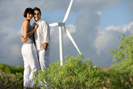 Couple stood by wind farm photo