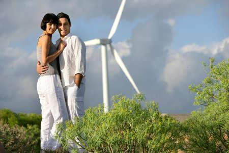 Couple stood by wind farm Stock Photo - 11972682