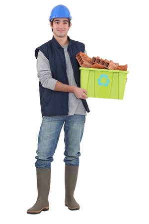 Builder stood with box of recyclable material Stock Photo - 11970177