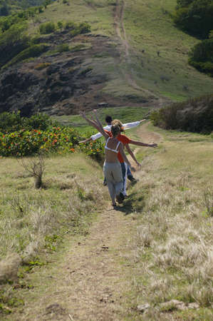 Group walking down hillside photo