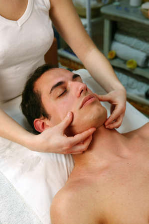 face massage: Man receiving face massage Stock Photo