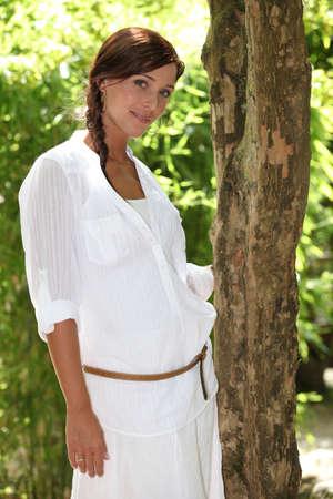 portrait of lovely brunette posing near tree in park Stock Photo - 11973416