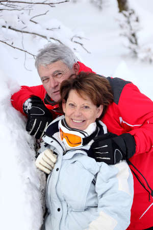 Mature couple in the snow photo