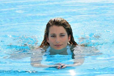 Blind woman swimming photo