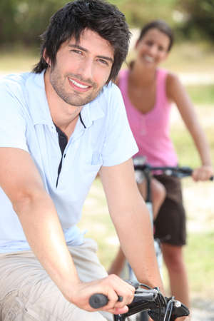 couple riding bicycle photo