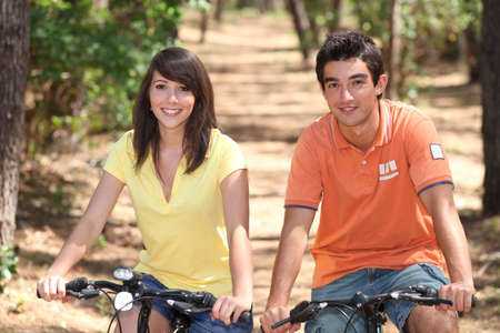 Teenage couple on bike ride photo