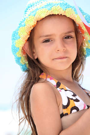 petite girl: Young girl in a bikini and sunhat