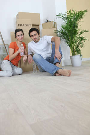 Tired couple on moving day photo