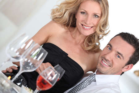 dinner party people: couple at dinner Stock Photo