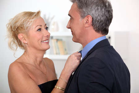 greying: Husband and wife going out for a romantic meal Stock Photo