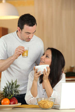 Couple eating breakfast photo