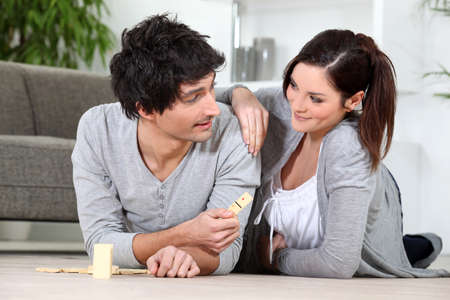 Couple playing dominoes photo