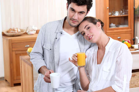 A nice couple having morning drinks. photo