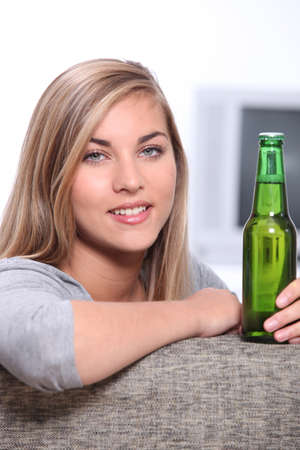 Teenager with a bottle of beer photo