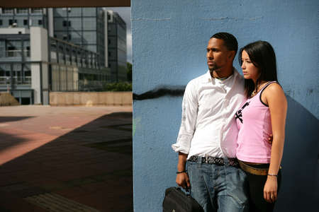 Couple stood by wall photo