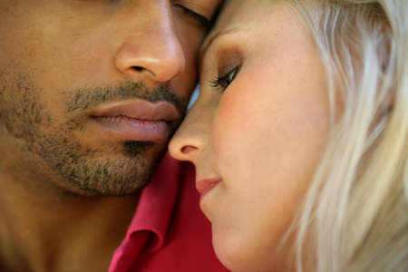 interracial relationships: Intimate couple Stock Photo