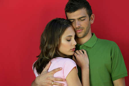 Affectionate couple stood close together Stock Photo - 11993724
