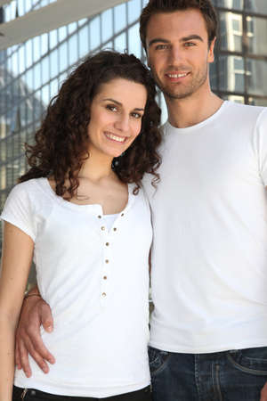 hands on waist: Young couple in the city