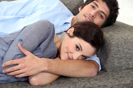 Couple lying on sofa photo