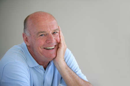 dentures: A smiling elderly man
