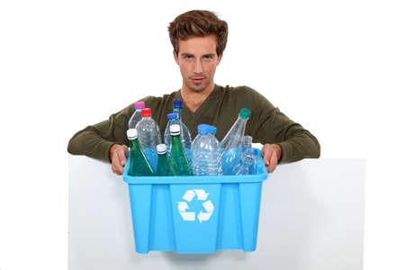 reprocess: Man holding box full of empty bottles