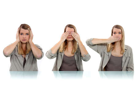 woman covering her eyes, ears and mouth with her hands photo