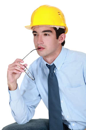Engineer trying to find a solution to a problem Stock Photo - 11973193