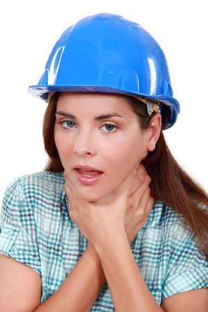 to strangle: craftswoman choking herself