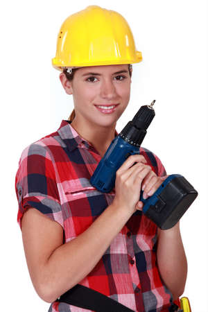 Pretty girl holding an electrical screwdriver photo