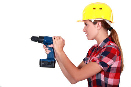 cordless: Woman with a cordless drill Stock Photo