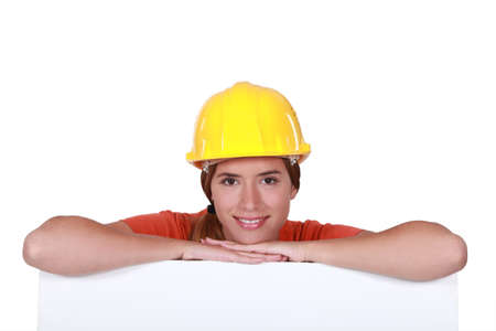 woman hard working: A portrait of a female construction worker.