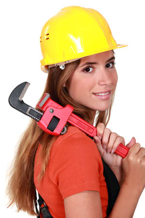 craftswoman: beautiful craftswoman holding a spanner Stock Photo