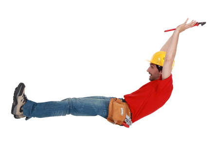 alarmed: Tradesman jumping in the air