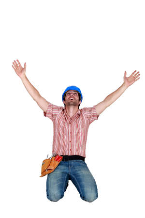 obliged: craftsman raising hands
