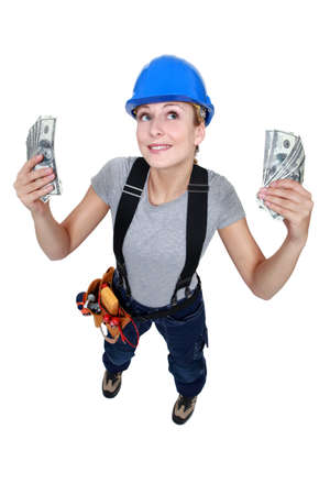 wads: Tradeswoman holding up wads of cash