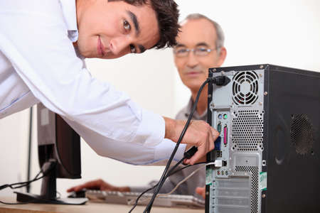 technical support: Computer technician repairing PC Stock Photo