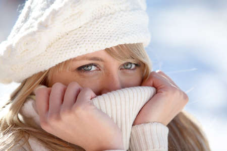 blue eyed: blonde wrapped in pullover by cold weather