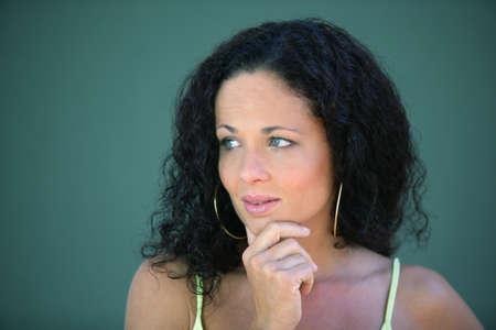 Pensive brunette stood outside photo