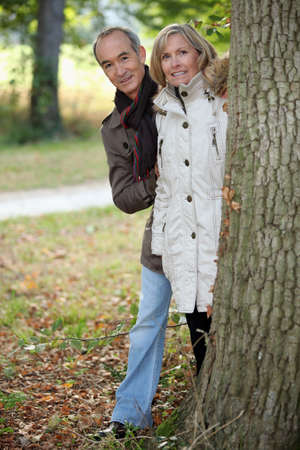 55 59 years: Mature couple out for an autumn stroll Stock Photo