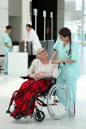 Nurse with an elderly lady in a wheelchair photo