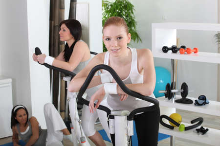 Three women working out in a gym photo