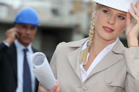 Female architect with plans on site Stock Photo - 11972725