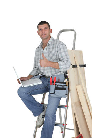 Carpenter ordering stock on-line photo
