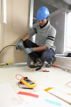 black electrician at work photo