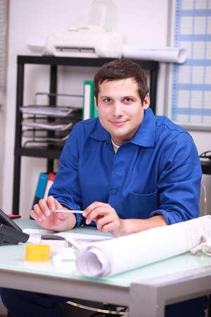 skilled operator: Mechanic sitting in office Stock Photo