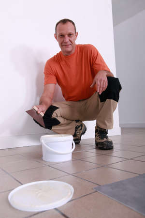 handyman going to put glue Stock Photo - 12008046